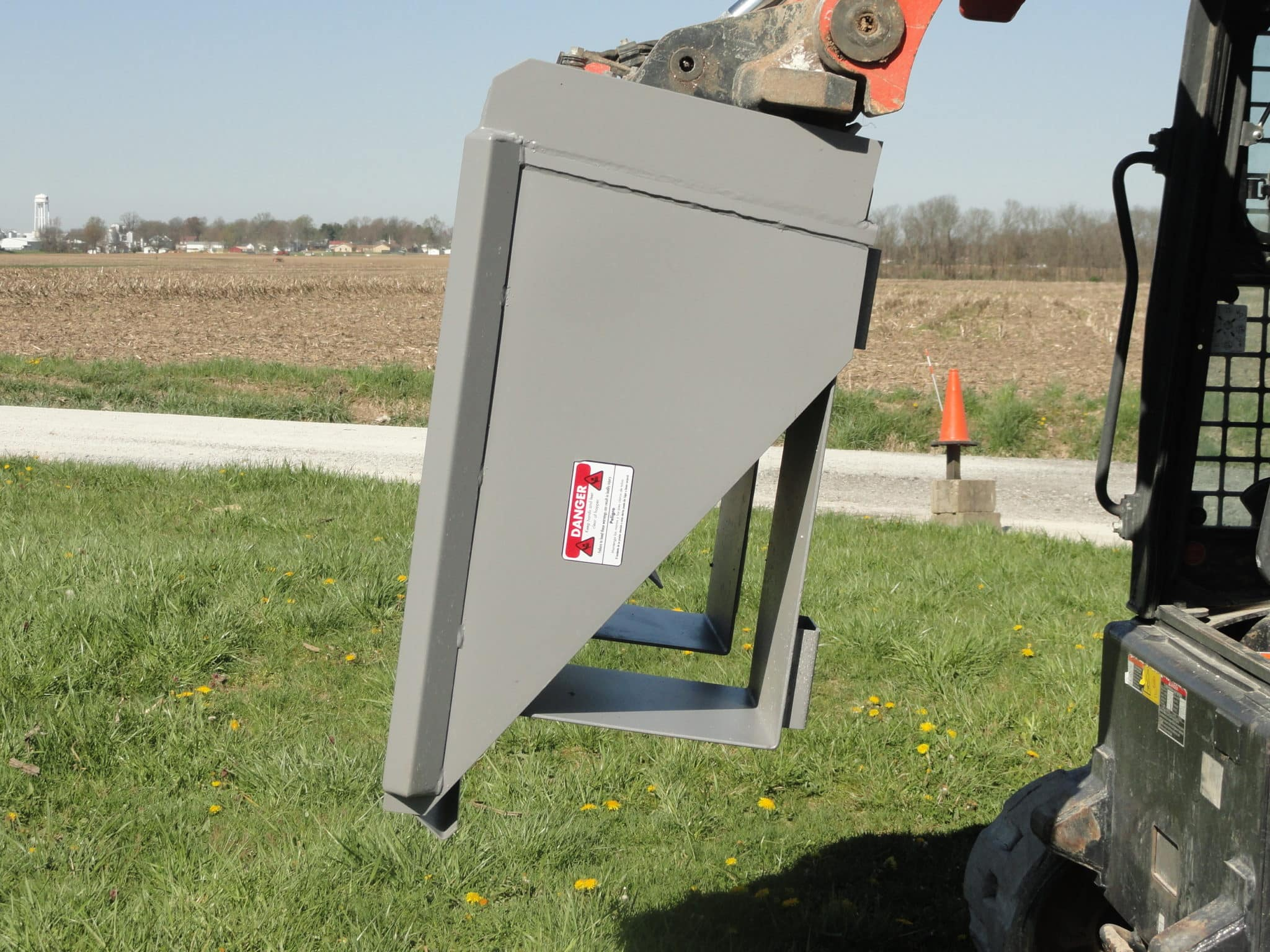 Quick attach hopper for skid steers